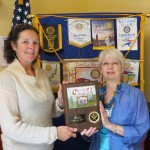 President Caryl accepts plaque from Albany Little League